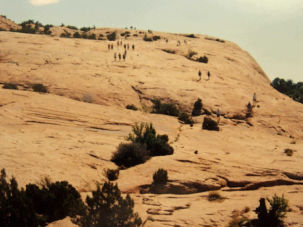 Hikers on the delicate arch trail.