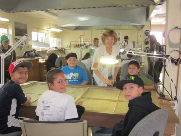 "Volunteer Lou and Imperial Valley's Sunflower Elementary students at the Anza-Borrego State Park Paleo lab ""cleaning"" ""fossil"" bones"