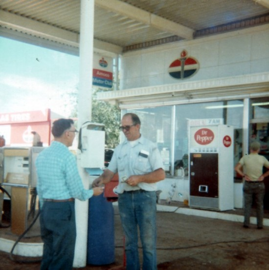 In the early 70's the canopy was built over the pumps, and the station changed from Standard Oil to Amoco.  This was the Amoco era.  I can get specific dates from my mom if you need them. Pat is Center, I don't have info on the other two men, probably just random customers.    A few years after this photo, a Semi missed the turn from Moab to Thompson and took out the whole awning and the first row of pumps.  I have some photos from that morning.  Lucky it wasn't a big fireball.