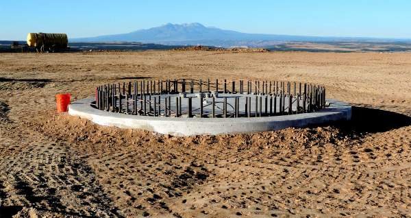 Close-up of tower foundation. La Sal Mountains in the distance.