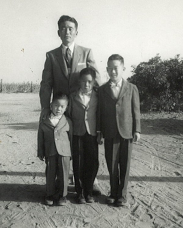 My Dad, John Mikuni, and brothers (L-to-R) Dennis (age 3), Ron (age 7), and me (age 9) at our Fresno farm.
