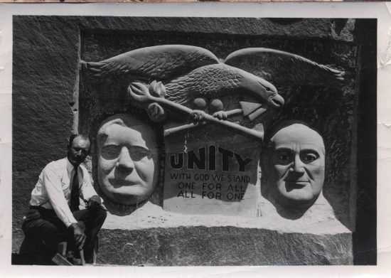 "Albert Christiansen with his ""Unity Monument."""