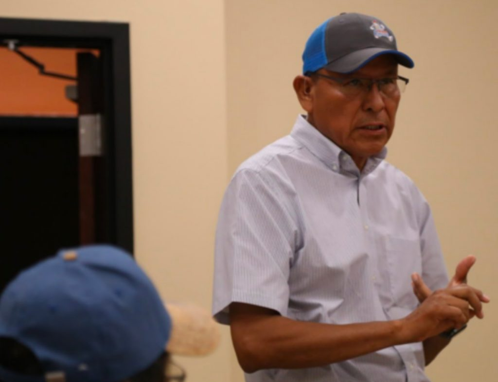 Mark Maryboy speaks at a town-hall style meeting at the Mexican Water chapter of the Navajo Nation. (Kate Groetzinger/KUER)