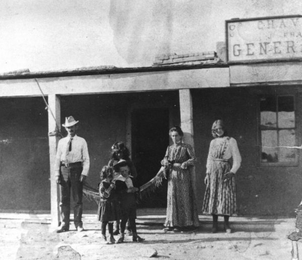 The Chavez, New Mexico store. Left to right: John Wetherill, Sister and Ben Wetherill in front of an unidentified Navajo boy, Louisa Wetherill, and Lillian Scurlock.
