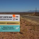 A yard sign-style campaign message of the San Juan County Democratic Party on Highway 262 just inside the Aneth extension of the Navajo Nation was modified in advance of a special election on Nov. 5. The signs were positioned along highways in the southern part of the county. (Bill Keshlear)