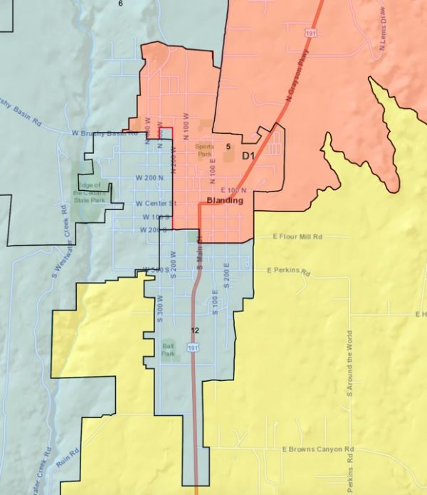 A ruling in federal court split Blanding and its outskirts into three San Juan County Commission districts. As a result, the county's largest city has no designated representative on the commission. The two Navajo commissioners, who form a majority voting bloc, live miles away and do not conduct anything resembling constituent outreach in town.