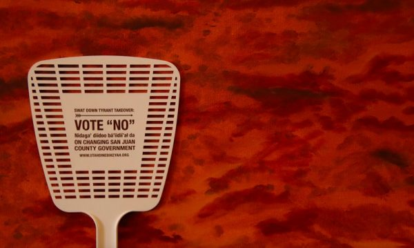 "The limits of kumbaya: Schwag at a pre-election rally held in Arizona included fly swatters that say, ""Swat down tyrant takeover"" and includes the website address of Salt Lake City-based Utah Diné Bikéyah. (Bill Keshlear)"