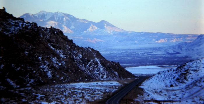 Then-US 163 headed south... 1975 Moab in the middle ground, the La Sals in the distance. photo by Jim Stiles