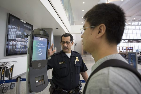 U.S. Customs and Border Protection, Office of Field Operations, officers take biometric photos of passengers prior to boarding a flight at Houston International Airport on February 12, 2018.   Photographer: Donna Burton