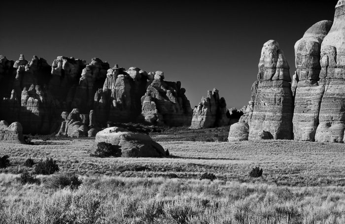 In the heart of Canyonland's Needles District, Chesler Park offers stunning views of desert grasslands and sandstone formations. Concerned about the environmental impact of jeep travel, park officials decided to close Chesler to motorized vehicles in the late 1960s. — Michael Denis