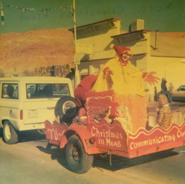 KURA's Float in the 1972 Moab Christmas Parade. Note Tom Balsley's Sears store in the background. Photo courtesy Deeanne Tranter Atwood.