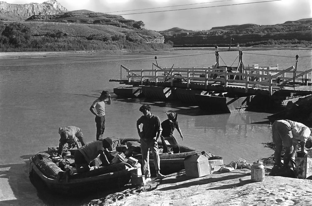 rigging the two boats alongside the old Hite Ferry at the mouth of White Canyon. (courtesy of the Todd Webb Archives, Portland, Maine USA)