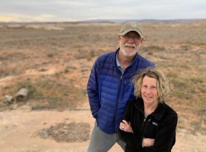 Bluff Mayor Ann Leppanen and Bluff Town Councilman Brant Murray stand where a solar farm might sprout photovoltaic panels on the Bluff Bench just north of town. They say the proposal would mar the view of land designated by President Obama as Bears Ears National Monument in 2016. The acreage is no longer within boundaries of the current monument. (KUER)