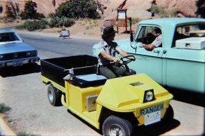 the yellow Cushman cart