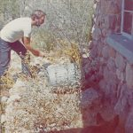 Ed live-captures rattler. Why would anyone want to kill a rattler at his front door? Photo by the author. Tuscon, 1971