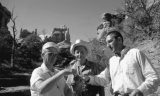 Senator Frank Moss, Superintendent Bates Wilson, and Secretary of the Interior Stewart Udall in the Maze area sharing water and planning for Canyonlands' expansion, August 1968. Congress added the Maze District to Canyonlands in 1971.