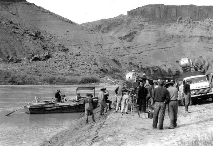 Film crew and river boats; note Castle Valley anticline in background. (K. Ross collection)