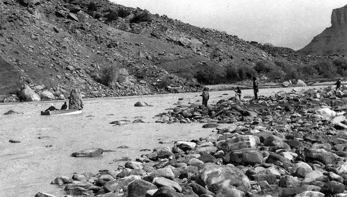 "Securing the fiberglass ""rock"" in mid-current; river flowing right to left (K. Ross collection)"