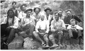 Eleven of the Fourteen Members of the 1909 Rainbow Bridge Expedition. Left to right: Jim Mike, John English, Dan Perkins, John Wetherill, Jack Keenan, Byron Cummings, Jean Rogerson, William B. Douglass, Neil Judd, Don Beauregard, and Malcolm Cummings.