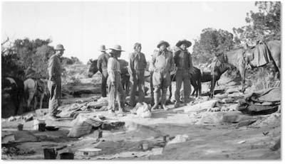 We can deduce with certainty that the man on the right, standing next to Theodore Roosevelt, is the Paiute guide, Nasja Begay