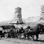 "On one of her early trips to Kayenta, Lillian Wilhelm and her friends had to revert to old ways. Elephants Feet formation in the background. ""Each time a Navajo hitched his ponies to a stubborn mass of metal and towed it to its destination, he thought a white man was stupid to forget that a horse was his best friend,"" wrote Lillian's friend, Mildred Kaye Smith."