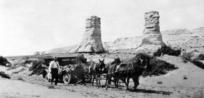 """On one of her early trips to Kayenta, Lillian Wilhelm and her friends had to revert to old ways. Elephants Feet formation in the background. """"Each time a Navajo hitched his ponies to a stubborn mass of metal and towed it to its destination, he thought a white man was stupid to forget that a horse was his best friend,"""" wrote Lillian's friend, Mildred Kaye Smith."""