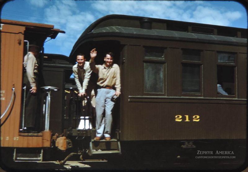 Fellow rail fans from Ohio wave from the 212 Combine Platform enroute to Silverton. 1948. Photo by Herb Ringer.