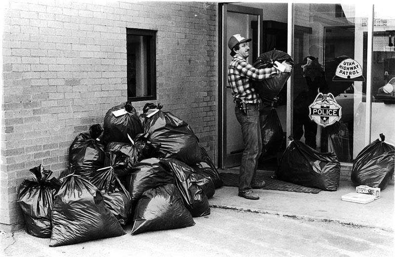 Deputy Roy Daughetee moves bags of pot into the sheriff's office. Photo by Bill Davis