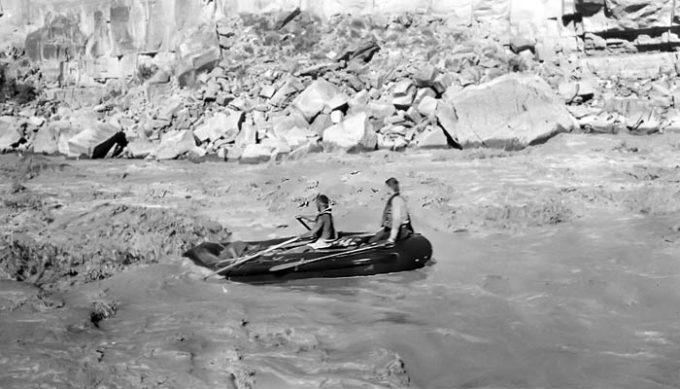 1949 Dick Griffith on oars in Dark Canyon Rapid with passenger Jon Lindbergh