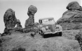 Harry Goulding, founder of Goulding's Trading Post in Monument Valley, driving at Arches in the early 40s. Photo by Harry Reed.