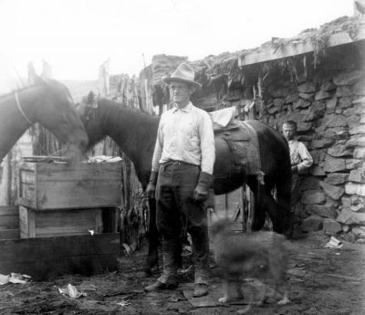 John Wetherill, age 42, and Malcolm Cummings, age 11, in 1909 at Wetherill's Oljato, Utah, home and trading post.