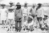 Stuart Young's photo of the expedition members just after they forded the swollen San Juan River. Back row, left to right: Byron Cummings, William Blum, Neil Judd, Edgar Lee Hewett, Dogeye Begay. Front row: Malcolm Cummings, Randolph, Donald Beauregard, and John Wetherill.
