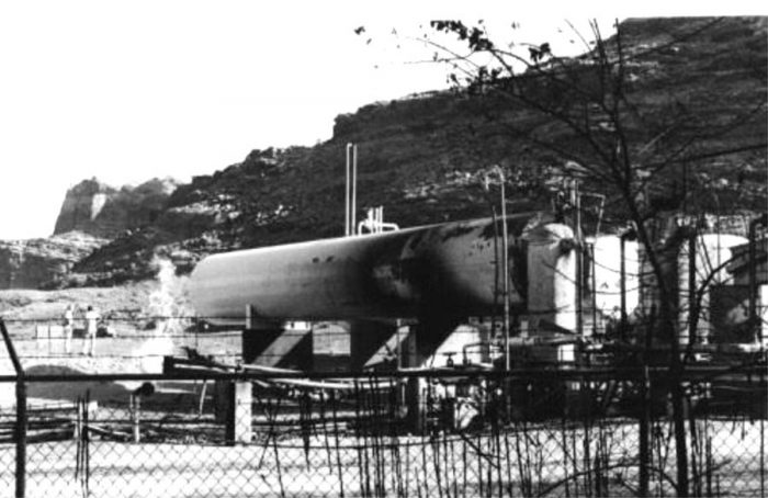 This is a shot taken from the campground looking into the gas plant, showing the scorched tank authorities feared would become a BLEVE, and possibly explode the other storage tanks. This is the tank the flames were wrapped around in the nighttime shots. The small flame seen emanating from the pipe is the one all three Salt Lake affiliate TV reporters used as a backdrop for their stand-ups.