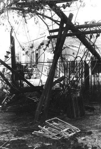 The downed power pole that blacked out the entire town after the explosion. In the foreground are the remains of the tent in which the two brothers, ages 7 and 8, who later died, were sleeping.