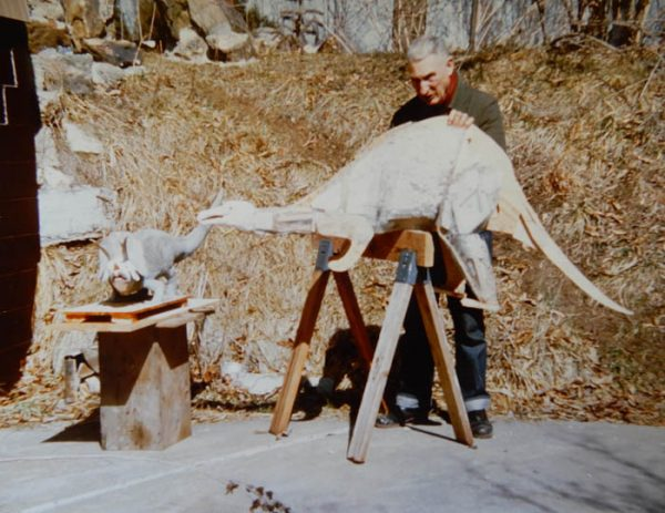 George at work with his dinosaurs. Photo by Doc Bell.