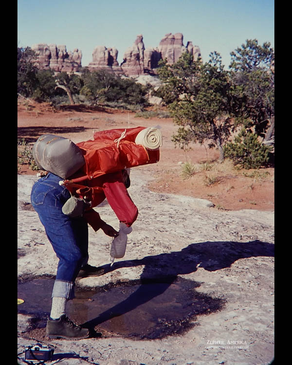 """Gathering water """"spoonful by spoonful"""" in Chesler Park. The Needles District of Canyonlands. JULY 1972. Photo by Edna Fridley"""