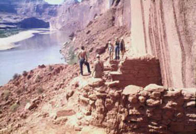 Inspecting cliffside dwellings on April 1962 trip as waters rose