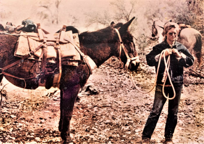 Becky Brock with Pete's Mule, Jane; Sept 1975 Grand Gulch. BLM photo