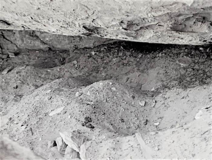 1974 Freshly dug pothunter pits in a Grand Gulch alcove.  BLM photo.
