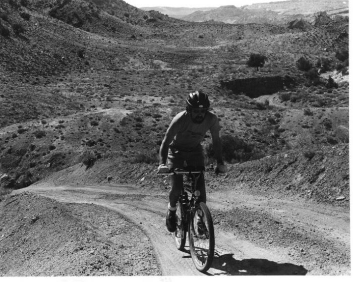 Charging up a hill in Arches National Park on the Delicate Arch Road during the summer of 1984. Photo by Kris Davis.
