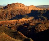 Figure 4. tilted rocky terrain lying between Mule Ear and San Juan River. (JR Lancaster photo)