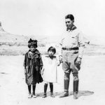 The artist and cartoonist, James Swinnerton, on the right with some real canyon kiddies—Betty and Fanny Wetherill